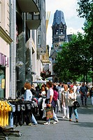 Sidewalk cafes and shoppers near Kaiser Wilhelm Memorial Church in Berlin