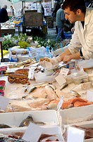 Fishmonger at food market