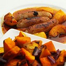 Pork sausages and apple