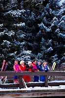 Ski Family Standing on a Bridge