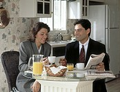 Executive couple having breakfast, MR
