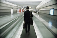 Man on moving walkway in airport