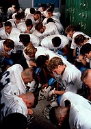 Yorktown Patriots high school football team kneels in locker room for a moment of silence before game in Arlington, Virginia.