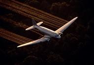Aerial spraying of pesticide Malathion from DC3 near Taunton, Massachusetts. Malathion controls the mosquito population.