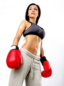 Latin woman with boxing gloves