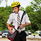 Businessman Wearing Cycling Helmet Outdoors