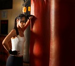 Young Woman Working out with Punching Bags
