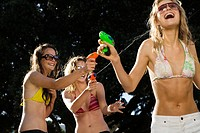 Teenage Girls with Squirt Guns