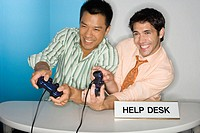 Men Playing Video Games at Help Desk (thumbnail)