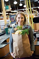 Woman Holding Full Grocery Bag
