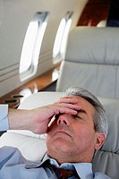 Businessman Resting on Private Jet