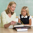 Teacher With Elementary Student