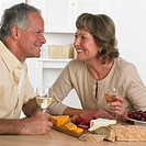 Couple Enjoying Cheese and Wine Buffet
