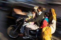 Indian family on speeding motorcycle. Udaipur. Rajasthan. India.