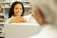 Woman Filling Prescription at Pharmacy