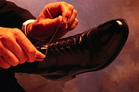 Businessman Tying Shoe