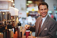 Businessman Preparing Coffee