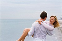 Sandy beach, man, woman, carries, happy  30-40 years, partnership, relationship, leisurewear, white dressed, falls in love, love, flirts, flirt, ´on h...