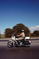 California Highway Patrol Officer Riding a Motorcycle