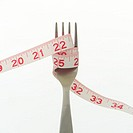 Measuring Tape Wrapped Around Fork (thumbnail)