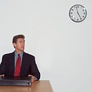 Impatient Businessman Watching Clock (thumbnail)