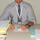 Businessman Stamping Documents
