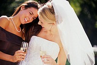 Bride Drinking Champagne with Friend