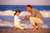 Father and Daughter Collecting Shells