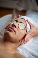 Woman Preparing to Give Man Facial at Spa