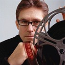 Man Holding Film Reel