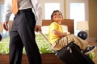 Child Riding on Father´s Suitcase
