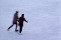 Couple Holding Hands and Ice Skating