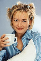 Woman Drinking Morning Coffee in Pajamas