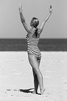 Woman Posing in Swimsuit at the Beach