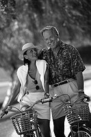 Elderly Couple Bicycling Together