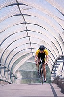Bicyclist Riding on Overpass
