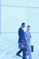 Businessmen Hurrying Down Steps