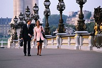 Business People Walking on Bridge