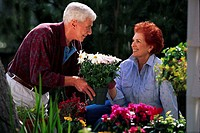 Middle-Aged Couple Planting Flowers
