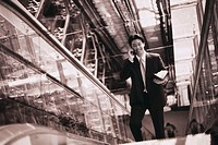 Businessman on an Escalator
