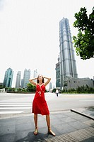 Woman in front of Shanghai Financial Center. Shanghai (Pudong), China
