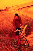 Bicyclist in Tall Grass on Beach