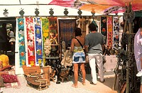 Spain, Ibiza, Sant Carles,  souvenir shop, tourists,  view from behind, no models release , island, hippie market of reading Dalias, market, business,...