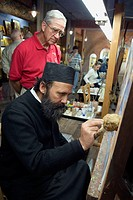 Kalambaka, Greece, Father Pefki, a monk and icon painter in ihs studio and showroom near Meteora.