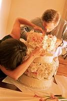 Bakers Making a Wedding Cake