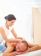 Woman Massaging Man