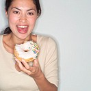 Woman About to Eat Donut