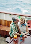 Couple Enjoying Tropical Drinks on Ship
