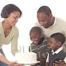 Mother Showing the Birthday Cake to Family