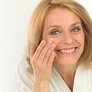 Middle-aged Woman Applying Facial Cream